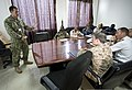 U.S. Navy Petty Officer 2nd Class Marcus Loen, left, briefs representatives from Somalia, Sudan, Djibouti, the Netherlands and the United States during Cutlass Express 2013 at the Port of Djibouti in Djibouti 131111-F-NJ596-021.jpg