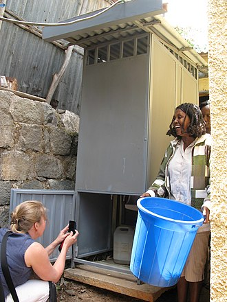 Urine-diverting dry toilet - Exchanging the feces container of a low-cost single vault UDDT at a household in Addis Ababa, Ethiopia