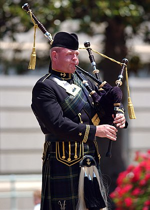 A bagpiper with the U.S. Naval Academy Pipes a...