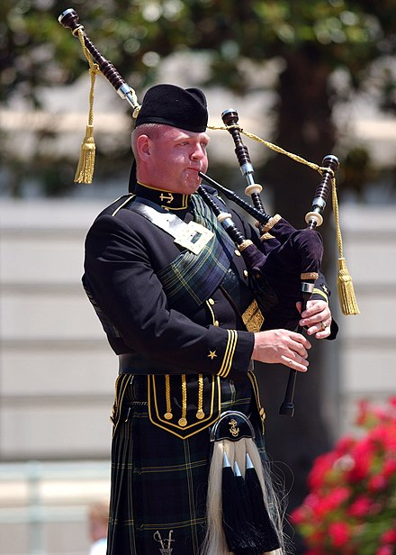 A bagpiper with the U.S. Naval Academy Pipes and Drums US Naval Academy Pipes and Drums bagpiper.jpg