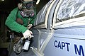 US Navy 020724-N-2781V-016 Aircraft painting and maintenance aboard ship.jpg
