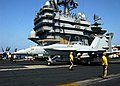 US Navy 021005-N-9593M-039 F-A-18E taxis past the superstructure.jpg