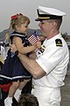 US Navy 030506-N-5686B-028 Lt.j.g. Matthew Molmer is greeted by his daughter upon disembarking from the guided missile cruiser USS Cowpens (CG 63).jpg