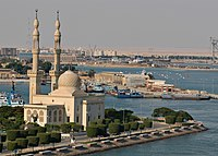 US Navy 031013-N-6187M-001 The nuclear powered aircraft carrier USS Enterprise (CVN 65) passes an Islamic mosque on the western bank of the Suez Canal while transiting to the Red Sea.jpg