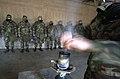US Navy 040110-N-6157F-022 Marine Gysgt. Victor Szalankiewicz, the Marine advisor to Naval Mobile Construction Battalion Two Three (NMCB-23) burns tear gas.jpg