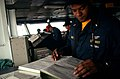 US Navy 040407-N-9851B-096 Communications Junior Officer of the Watch (JOOW) Ens. Dempsey Barnes makes log entries on the bridge of the nuclear powered aircraft carrier USS Harry S. Truman (CVN 75) following a General Quarters.jpg