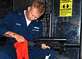 US Navy 040608-N-2382W-069 A Sailor assigned to Assault Craft Unit 4 (ACU-4) cleans his M-16 rifle.jpg