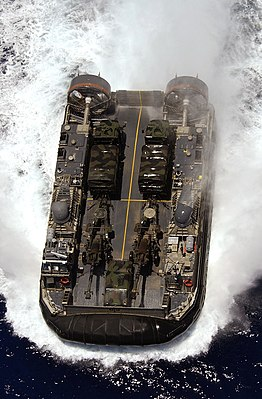 US Navy 040720-N-6811L-228 A Landing Craft Air Cushion (LCAC) assigned to the Swift Intruders of Assault Craft Unit Five (ACU-5) heads to the beach during amphibious assault training in support of RIMPAC 2004.jpg