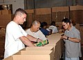 US Navy 040929-N-7912E-005 Sailors assigned to the amphibious assault ship USS Boxer (LHD 4), take time to give back to the community by helping the San Diego Food Bank pack boxes of food for needy families.jpg
