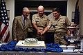 US Navy 041004-N-2383B-046 SECNAV, the Honorable Gordon England, Chief of Naval Operations (CNO), Adm. Vern Clark and Master Chief Petty Officer of the Navy (MCPON) Terry Scott commemorate the Navy's upcoming 229th Birthday,.jpg
