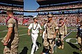 US Navy 050213-N-9076B-058 Commander, U.S. Pacific Command, Adm. Thomas Fargo, center, walks off the field with Purple Heart recipients prior to the kickoff of the 2005 NFL Pro Bowl in Honolulu, Hawaii.jpg