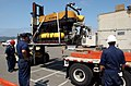 US Navy 050805-N-4633P-002 Sailors assigned to the U.S. Navy's Tethered Underwater Vehicle System (TUWVS) Detachment, located at Naval Air Station North Island, make preparations to load Super Scorpio.jpg
