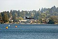 US Navy 050806-N-3390M-019 The lead solo pilot assigned to the U.S. Navy flight demonstration team, the Blue Angels, conduct a high-speed, low level pass over Lake Washington.jpg