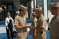 US Navy 050819-N-0438A-063 Chief of Naval Operations Mike Mullen hands a challenge coin to a master chief petty officer.jpg
