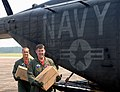 US Navy 050905-N-5526M-005 Crew members of a U.S. Navy MH-53E Sea Dragon helicopter, assigned to Helicopter Mine Countermeasure Squadron Fourteen (HM-14), unload boxes of water and Meals Ready-to-Eat (MRE's) in New Orleans for.jpg