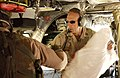 US Navy 051027-F-0571C-062 Commander, U.S. Disaster Assistance Center-Pakistan, U.S. Navy Rear Adm. Michael Lefever, helps unload a U.S. Army CH-47 Chinook helicopter.jpg