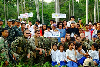 Balikatan - Philippine Marines and villagers from Tiptipon, Jolo pose with U.S. Marines and Sailors assigned to the 31st Marine Service Support Group, Balikatan 2006.