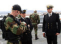 US Navy 060419-N-2893B-005 Guided-missile destroyer USS Porter (DDG 78) Visit, Board, Search and Seizure (VBSS) team members discusses tactics with Bulgarian Sailors.jpg