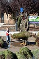 US Navy 061129-N-0888R-164 Cpl. Patrick Ross and his son pick out a donated Christmas tree at Miramar Marine Corps Air Station.jpg