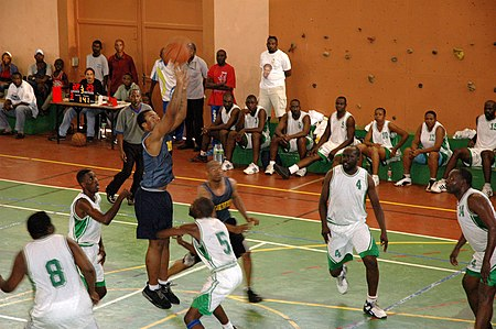 US Navy 070210-N-4657D-001 Operation Specialist Seaman Travon Cuffee a member of the guided-missile frigate USS Kaufman (FFG 59) basketball team, puts up a shot against a local Gabonese team.jpg