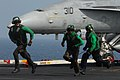 US Navy 070308-N-2659P-172 Sailors assigned to launch and recovery division aboard USS John C. Stennis (CVN 74) run across the landing area following inspection of the arresting gear wire after an aircraft boltered during recov.jpg