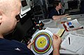 US Navy 070406-N-4009P-186 Aerographer's Mate 3rd Class Heath Collins, from Kirbyville, Texas, uses a psychometric calculator to determine the dew point and relative humidity for the current location of Nimitz-class aircr.jpg