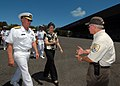 US Navy 070604-N-4965F-002 Commander, U.S. Pacific Fleet, Adm. Robert F. Willard and the Honorable Linda Lingle, Governor of Hawaii, speak with a member of the U.S. Fish and Wildlife Service as they cross the flight line of Mid.jpg