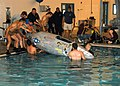 US Navy 070613-N-6247M-013 Sailors from Naval Air Station Whidbey Island's Aviation Survival Training Center (ASTC) and students from Everett Community College prepare to test a small submarine.jpg