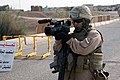 US Navy 070620-M-8476B-031 Lance Cpl. Luis Castillo, attached to 2nd Marine Expeditionary Force Combat Camera, videotapes Marines with India Battery, 2nd Battalion, 10th Marines, (I 2-10), conducting searches of Iraqi males.jpg