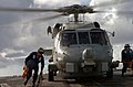 US Navy 070909-N-4420S-021 Boatswain's Mate Seaman Marshall Loyson and Boatswain's Mate Seaman Chad Carganilla remove the chalks and chains from an SH-60B Seahawk, assigned to the.jpg