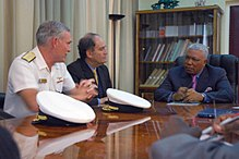 US Navy 071003-N-9580K-001 Rear Adm. Michael R. Groothousen, commander of Navy Region Europe, and Robert Weisberg, U.S. Ambassador to the Republic of Congo, meet with Republic of Congo Prime Minister Isidore Mvouba to discuss w.jpg