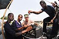 US Navy 080214-N-8933S-042 Chief Construction Mechanic Robert Turner explains to Ghanaian Sailors the importance of regular maintenance on motors during an Africa Partnership Station (APS) small boat maintenance course.jpg