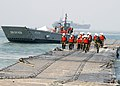 US Navy 080718-N-1424C-953 ivil Engineer Corp students take a tour of the Admin Pier as Assault Craft Unit (ACU) 1 landing craft mechanized departs the pier during Joint Logistics Over-The-Shore (JLOTS) 2008.jpg