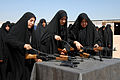 US Navy 090322-N-4245W-264 Iraqi female recruits disassemble AK-47 assault rifles during weapons training for recruits in basic training at the Iraqi Police Academy in Karbala, Iraq.jpg
