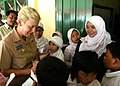 US Navy 090825-N-8539M-134 Rear Adm. Nora Tyson, commander, Logistics Group Western Pacific, signs autographs for students at Nural Falah Elemetary School.jpg