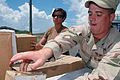 US Navy 090909-A-2742G-002 Aviation Electronics Technician 3rd Class William Boyer, assigned to the Joint Task Force Guantanamo Navy Expeditionary Guard Battalion (NEGB), loads supplies bound for Camp 4.jpg