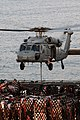 US Navy 091119-N-3038W-086 An MH-60S Sea Hawk helicopter assigned to the Wildcards of Helicopter Sea Combat Squadron (HSC) 23 lifts supplies from the flight deck of the Military Sealift Command fast combat support ship USNS Bri.jpg