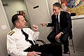 US Navy 100106-N-0696M-161 Chairman of the Joint Chiefs of Staff Adm. Mike Mullen speaks with Jon Stewart, host of the Daily Show before taping a segment of Mullen as the headlining guest.jpg
