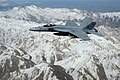 US Navy 100309-N-0000S-002 An F-A-18E Super Hornet assigned to the Pukin Dogs of Strike Fighter Squadron (VFA) 143 flies over the mountains of Afghanistan.jpg
