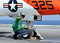 US Navy 100613-N-6509M-009 A Sailor performs a pre-flight check on a T-45A Goshawk aboard USS George H.W. Bush (CVN 77).jpg