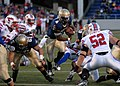 US Navy 101016-N-3857R-003 U.S. Naval Academy quarterback Ricky Dobbs (^4) carries the ball against Southern Methodist University during a college.jpg
