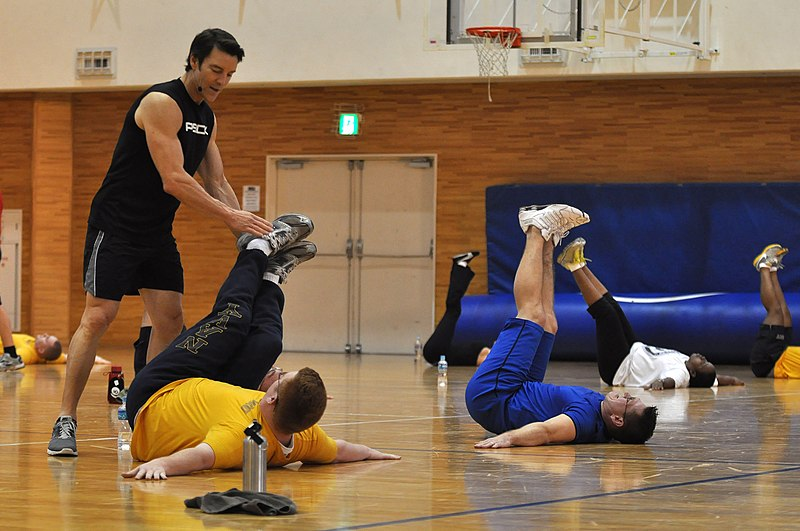 File:US Navy 110131-N-2013O-191 Tony Horton, inventor of the P90X workout system, instructs a Sailor on how to properly do an abdominal exercise during.jpg