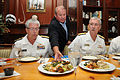 US Navy 110428-N-GO855-148 Hugh McCauley places a dish of food made by sea service culinary professional contestants between Vice Adm. Daniel P. Ho.jpg