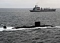 US Navy 110520-N-VQ827-895 The Royal Navy Trafalgar-class submarine HMS Torbay (S90) is underway in formation with the Military Sealift Command fle.jpg