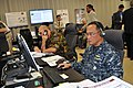 US Navy 110615-N-UN340-035 Space and Naval Warfare Systems Command (SPAWAR) reserve component officer Capt. Dan Gruta, right, and New Zealand army.jpg