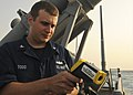US Navy 110705-N-YM590-020 Fire Controlman 2nd Class Dannon Todd uses a KPTRF-80 infra-red thermometer to test the water temperature as part of an.jpg