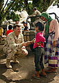 US Navy 130113-N-8668H-067 Commander, Expeditionary Group Five, Rear Adm. Christopher Ames, hands out candy to Indonesian children while visiting the Medical facility in the Tsunami-stricken city of Meulaboh, on the Island of S.jpg