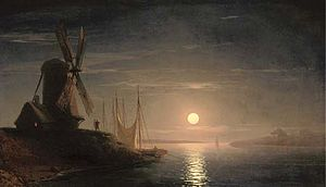 A windmill overlooking a moonlit bay