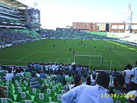 Football pitch during a game, seen from one end