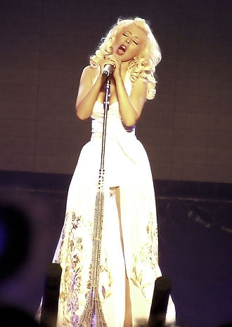 "Back to Basics Tour - Aguilera performing ""Understand"" in a mini-dress with long train"